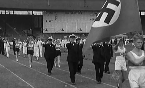Members of deaf German team proudly hail their leader, Adolf Hitler during the 1934 4th World Deaf Games in London.
